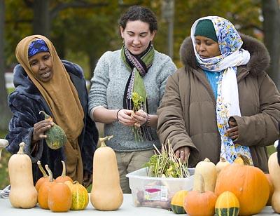 Sarah Davis 10 (center) with NASAP growers at the Lewiston Farmers Market.