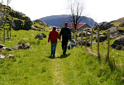 Skarstad worked for Norwegian sheep farmers Anders Braanaas and Hilde Buer, seen here walking hand in hand on an island adjacent to Grøneng Island, where Buer has her farm.