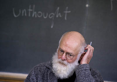 In a Bates classroom, author Denis Sweet, professor of German, is lost in unthought.