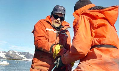In Kongsfjorden on the west side of Svalbard, Will Ambrose (facing) and Kelton McMahon '05 haul a dredge to collect Serripes groenlandicus and other clam species for McMahon's thesis in 2004. Photograph by Glenn Lopez, SUNY–Stony Brook.