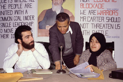 In this photograph by Randy Goodman, William Worthy (center) sets up a question-answer session at a Tehran hotel with Hossein Sheikholislam (left) and Massoumeh Ebtekar (right), spokespeople for the students who held 52 U.S. diplomats hostage for 444 days.