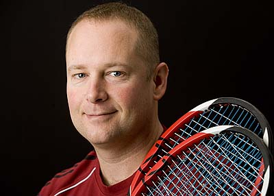 Like any serious player, men's tennis coach Paul Gastonguay '89 never travels with just one racquet. Photograph by Phyllis Graber Jensen.