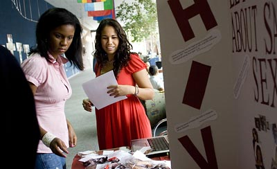 As part of her pschology course, Lisa DOyen works at an HIV/AIDS awareness table in the college center at Spelman College, the historically black womens college in Atlanta.