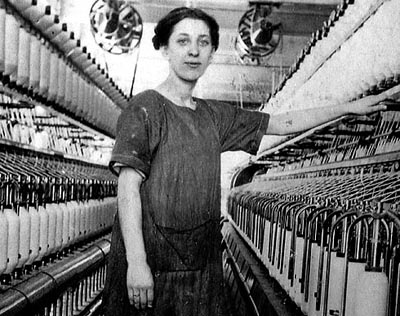 This 1920 photograph shows millworker Elizabeth Gagne amidst the Bates Mill spindles. Photograph courtesy of Museum L-A.
